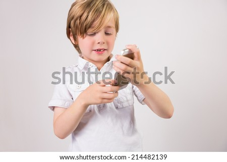Student using a mobile phone on white background - stock photo