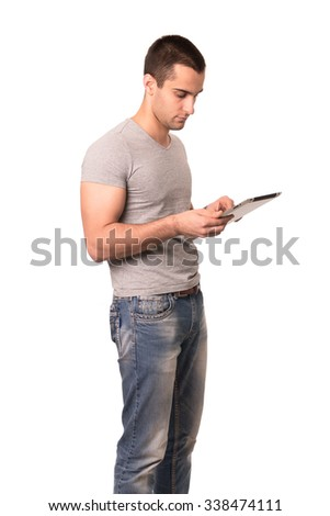 Student using tablet computer. Isolated on white background. - stock photo