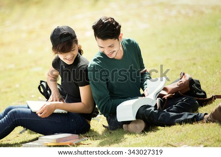 Student was reading in the outdoors and good weather. And they're happy. - stock photo