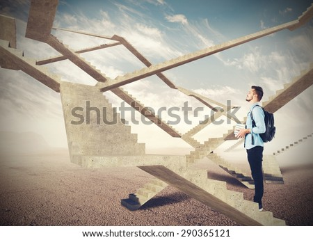 Student watching the endless stairs of future - stock photo