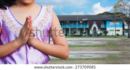 student wear uniform Thai gesturing in front of the school building , Welcome back to school - stock photo