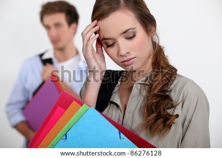 Student with a headache - stock photo