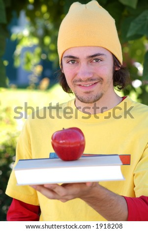 Student with apple - stock photo