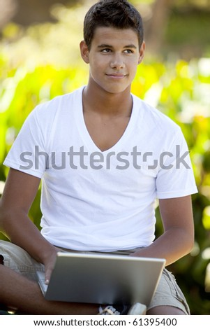 Student with backpack studying outside - stock photo