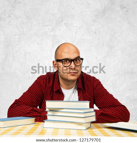 Student with books sitting at the table.