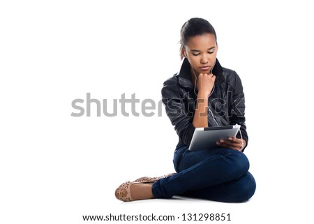 student with digital tablet sitting on the floor isolated on white - stock photo