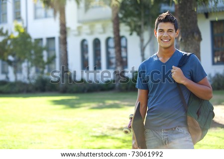 Student with skateboard and backpack outside school