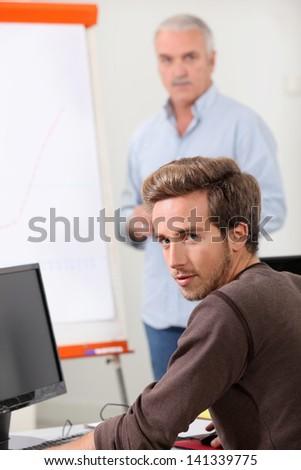 student with teacher at university - stock photo