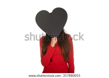 Student woman hiding behind heart made from paper. - stock photo