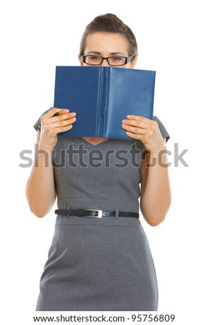 Student woman hiding behind notebook - stock photo