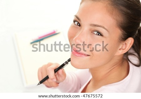 Student woman looking up while studying. - stock photo