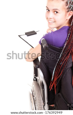 student woman on wheelchair, white background - stock photo