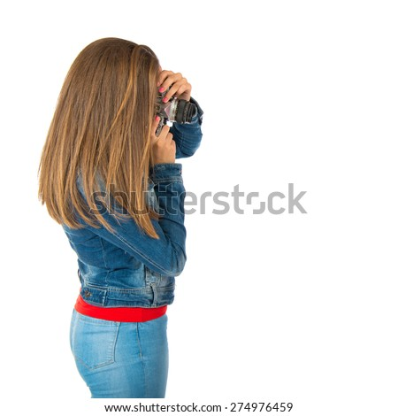 Student woman photographing over white background