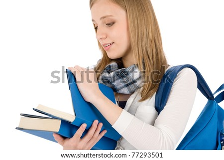 Student woman teenager with schoolbag look in books on white