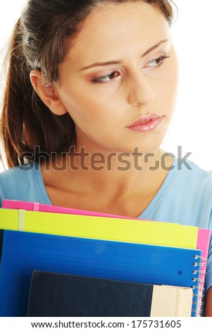 Student woman with depression, isolated on white - stock photo
