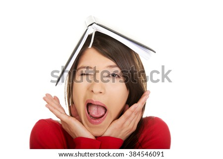 Student woman with her note on head. - stock photo