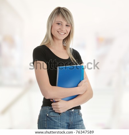 Student woman with note pad - stock photo