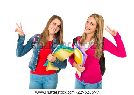 Student women doing victory gesture over white background