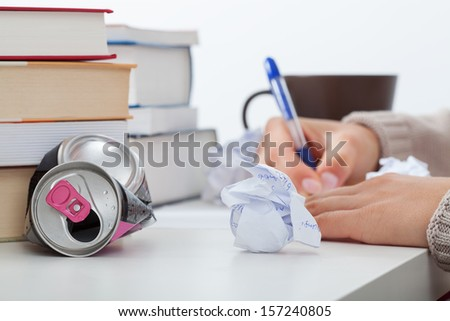 Student working hard on difficult math problem - stock photo
