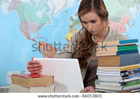 student working on her desk - stock photo