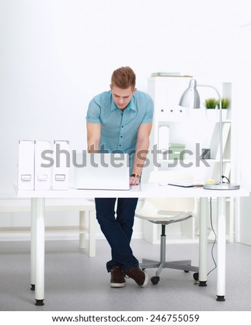 Student working on laptop in offine - stock photo