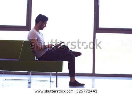 student working on tablet computer at university school modern interior - stock photo