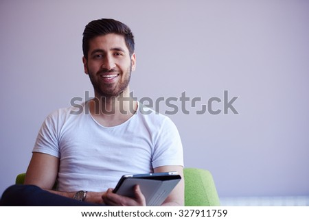 student working on tablet computer at university school modern interior