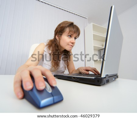 Student works with a laptop computer to the Internet - stock photo