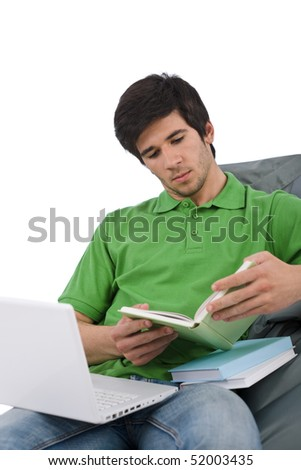 Student - Young man with laptop reading book sitting on bean bag on white background