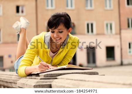 student young woman with notebook, outside - stock photo