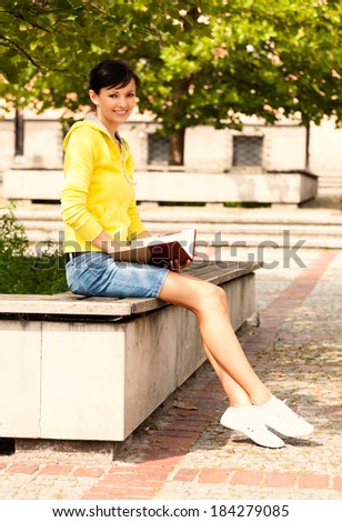 student young woman with notebook, outside