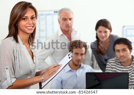 students and a teacher in a classroom - stock photo