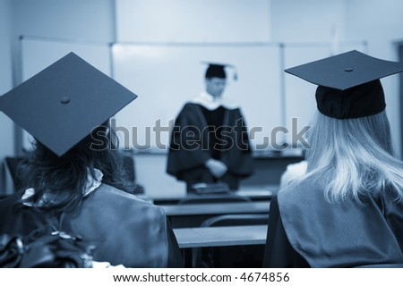 students and professor in gowns