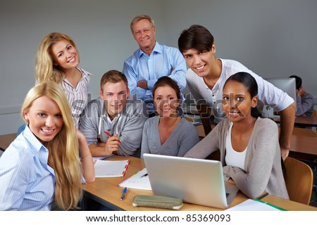 Students and teacher in course at university - stock photo