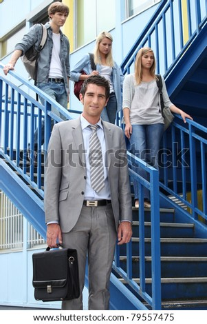 students and teacher in stairs - stock photo