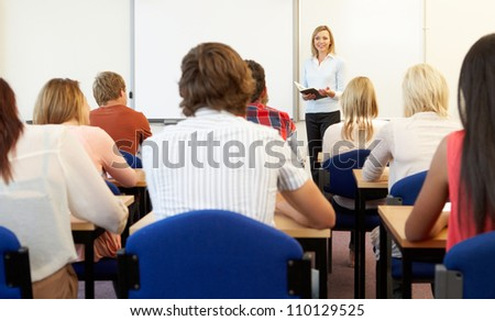 Students and tutor in class - stock photo