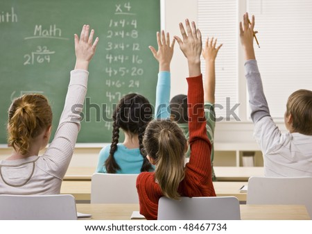 Students answering teacher question - stock photo