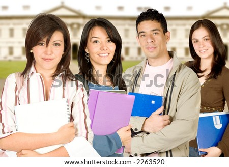 students at university - classic university in the background - stock photo