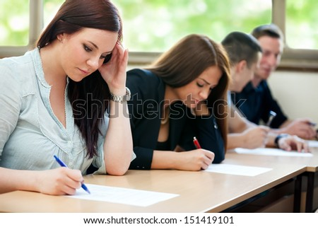 Students class have test in classroom - stock photo