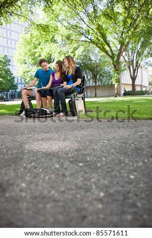 Students completing assignment at university campus - stock photo