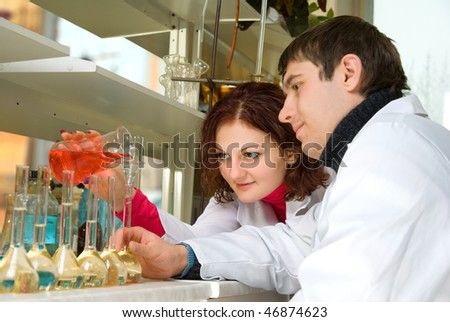 Students conduct experiments of chemists in the chemical laboratory - stock photo