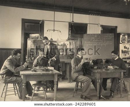 Students constructing telephones at Hampton Institute. African American higher education stressed practical skills and services, to counter employment discrimination for blacks. Ca. 1899.