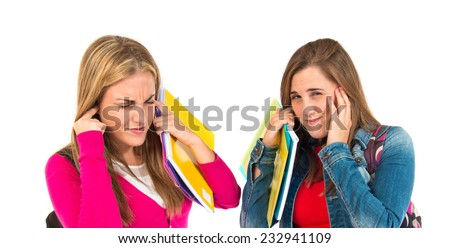 Students covering her ears over white background - stock photo