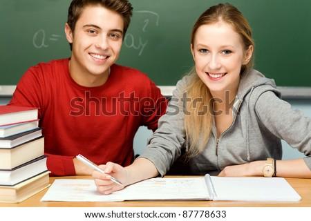 Students doing homework - stock photo