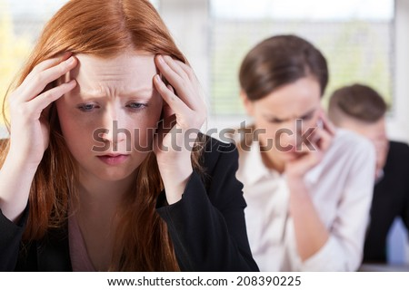 Students during difficult exam at school, horizontal - stock photo
