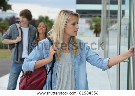 Students entering university building - stock photo