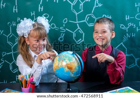 Students Grade 1, pigtails, globe, happiness, knowledge,