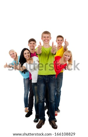 Students happy smiling friends group of young people holding thumb up gesture standing in row full length portrait isolated on white background - stock photo