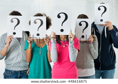 Students Hiding There Face With Question Mark Sign, uncertainty of their future concept - stock photo
