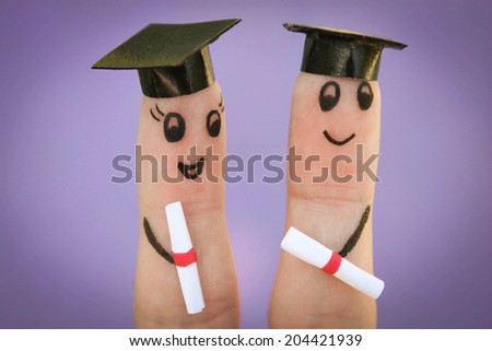 students holding their diploma after graduation  - stock photo